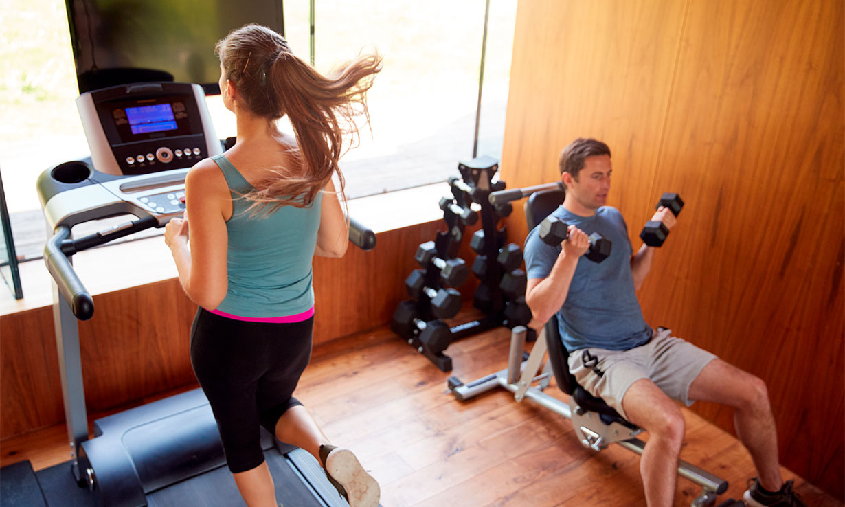 Couple using home gym