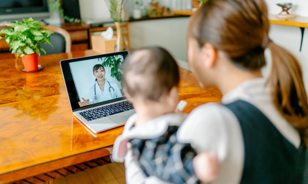 Mother and child having a virtual doctors appointment