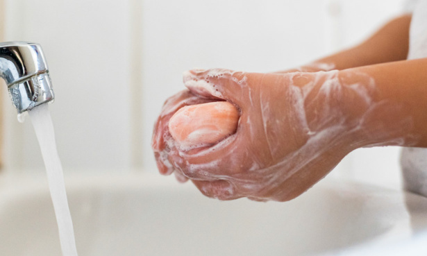 Washing hands with a bar of soap