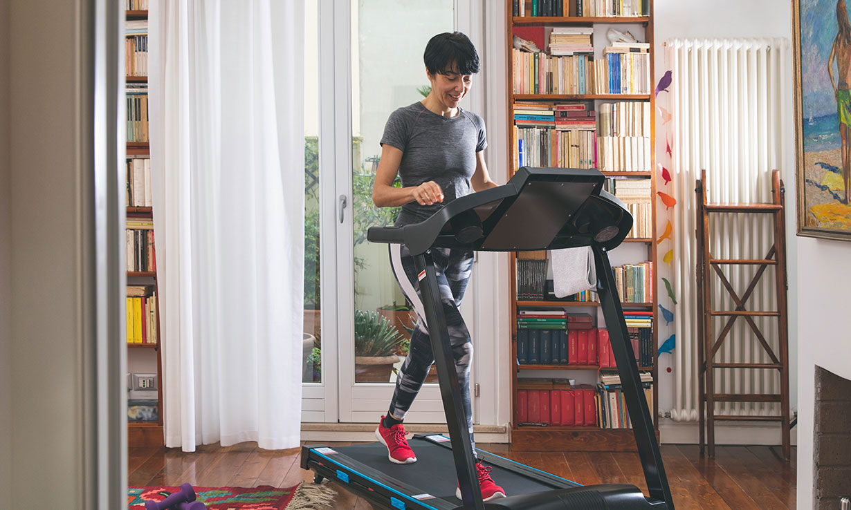 woman using treadmill at home
