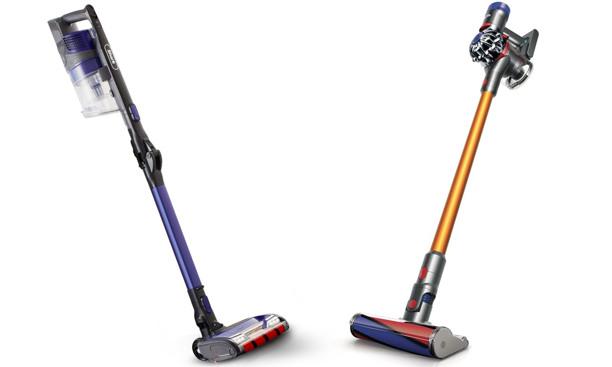 Dyson and Shark cordless vacuum cleaners facing each other