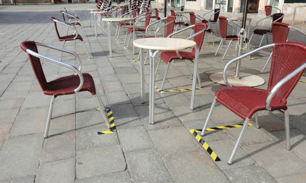 outdoor tables and chairs set up for social distancing