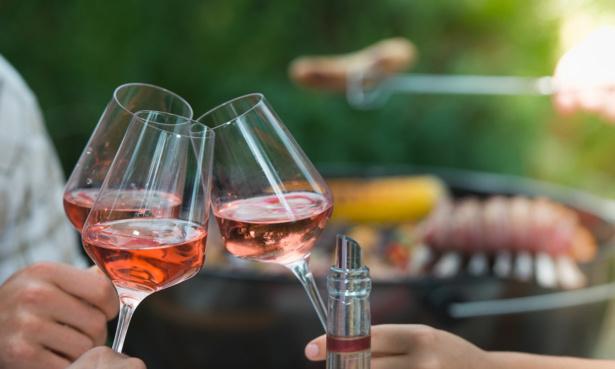 Three people toasting glasses of Rose