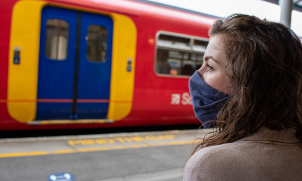woman wearing mask at station