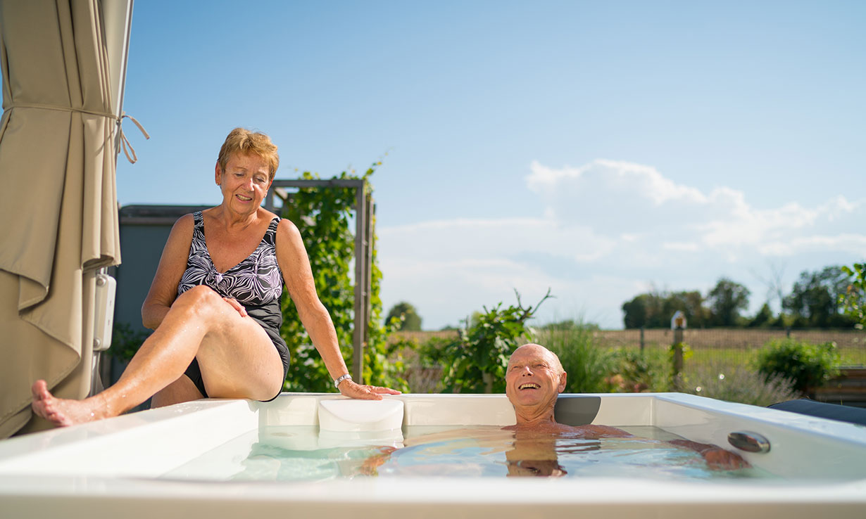 Elderly couple in a hot tub