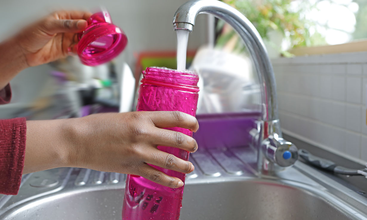 Filling up a reusable water bottle