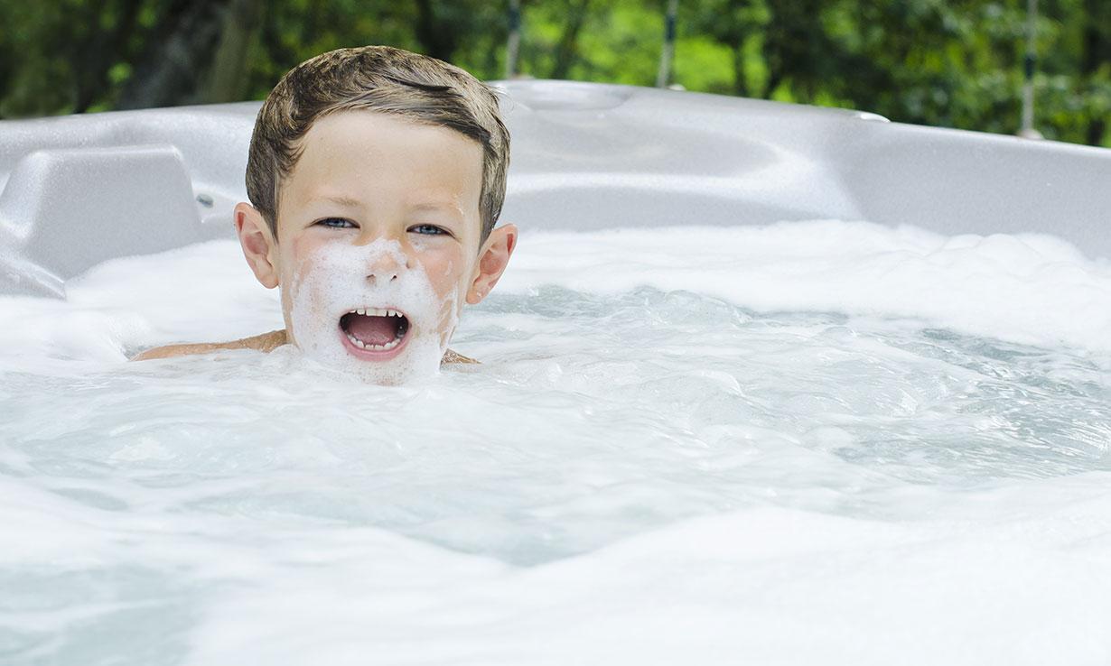 Boy in foamy hot tub