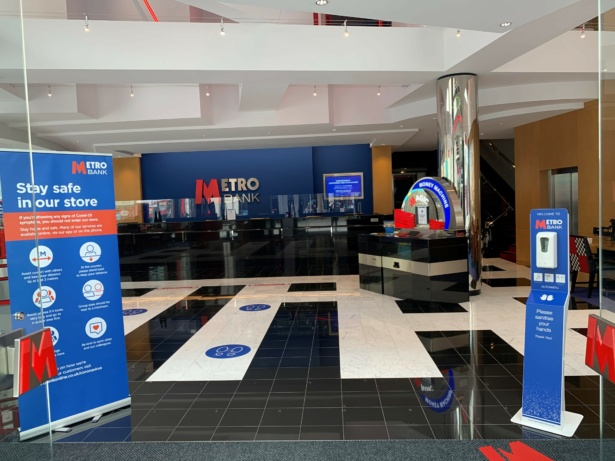 Metro Bank branch with hand sanitiser, perspex screens and social distancing floor markers