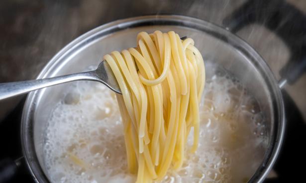 Boiling spaghetti pasta in a pan
