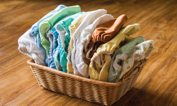 Collection of reusable nappies in a basket
