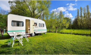 Caravan by river