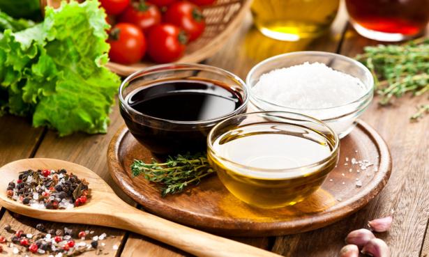 bowls of balsamic vinegar, salt and olive oil for making salad dressing