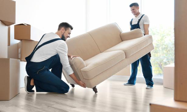 removal men lifting sofa