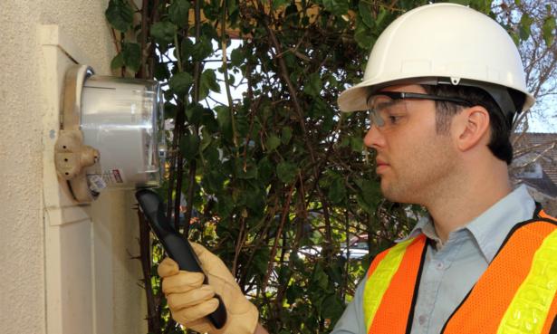 Engineer installing energy smart meter