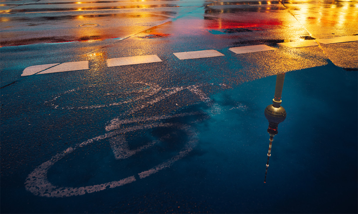Lights reflecting in puddles