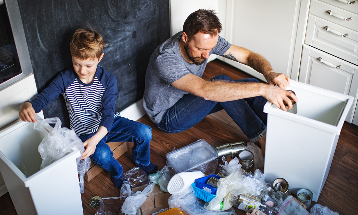 Man and boy sorting recycling