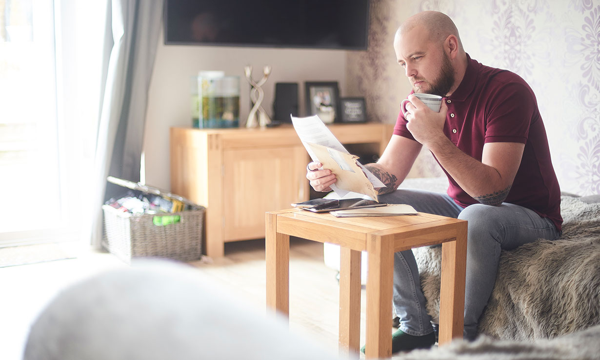Man reading a gas and electricity bill