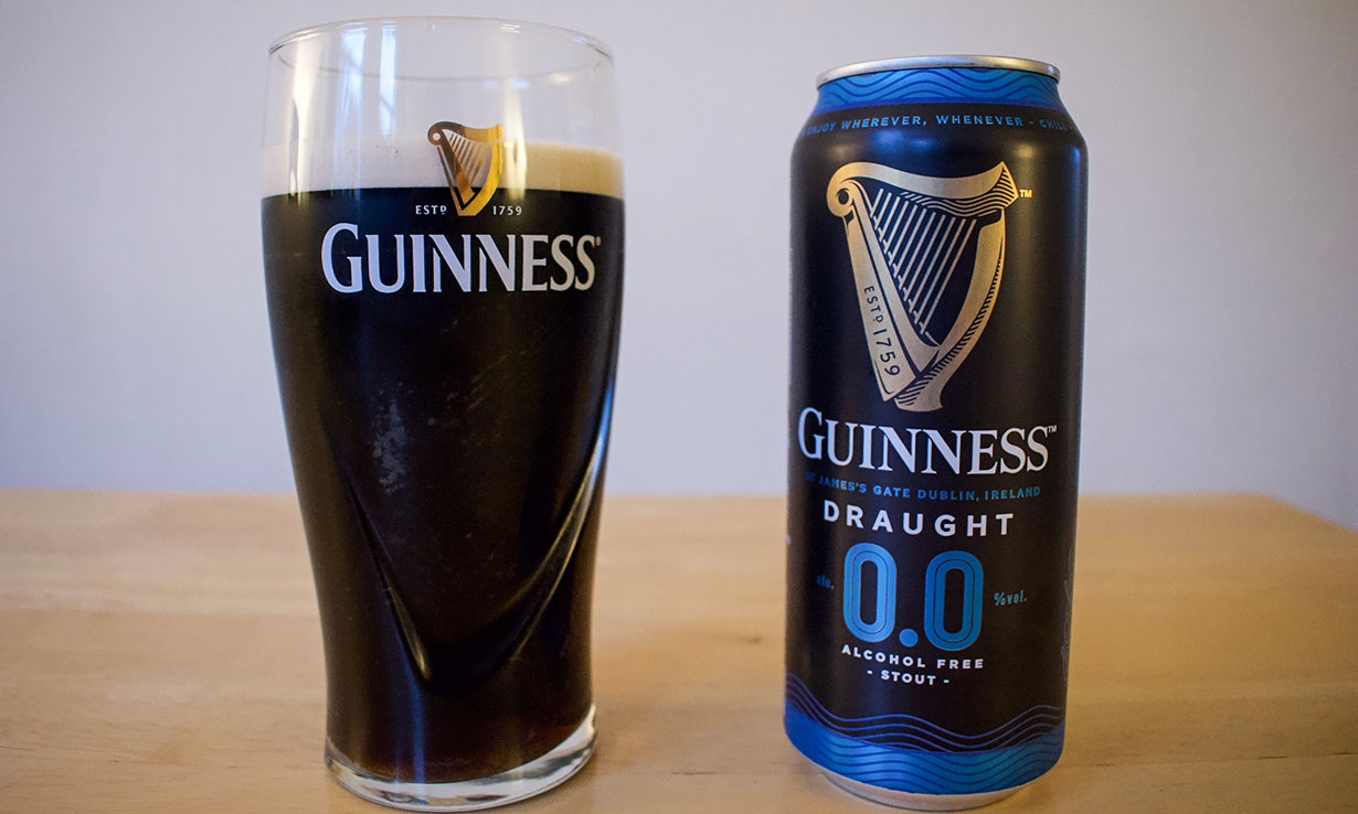 Can of Guinness 0.0 poured into a pint glass.