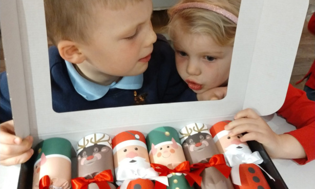 Children playing with Nancy & Betty Studio North Pole Friends Luxury Christmas Crackers