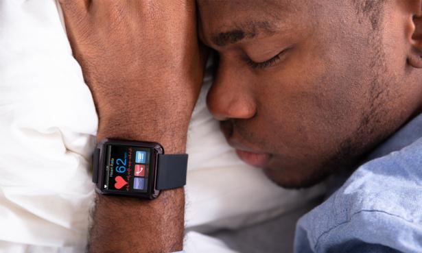 Man asleep wearing a smartwatch