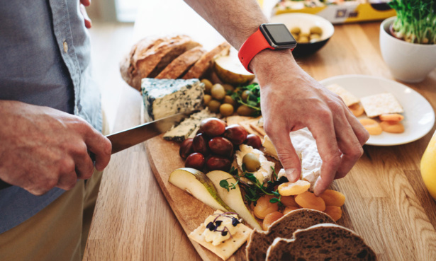 Person preparing christmas cheese board