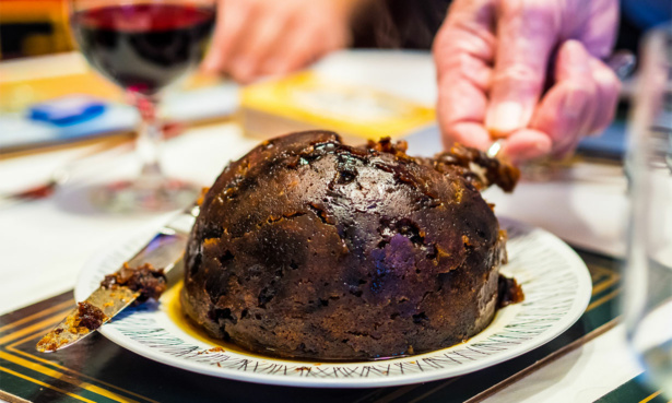 Serving Christmas pudding