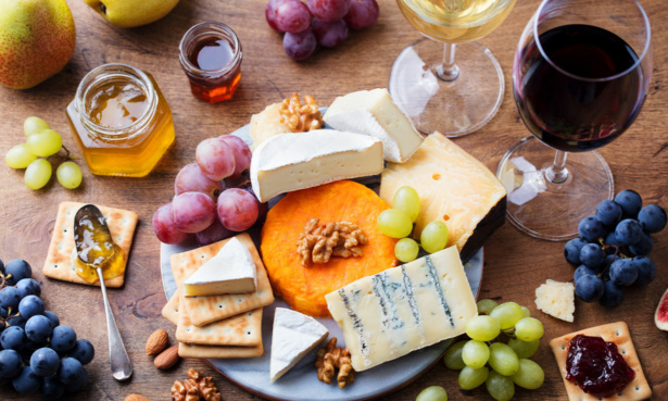 Cheese board with glasses of wine