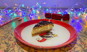 A slice on the ASDA Extra Special Baked Salted Caramel Cheesecake on a festive plate