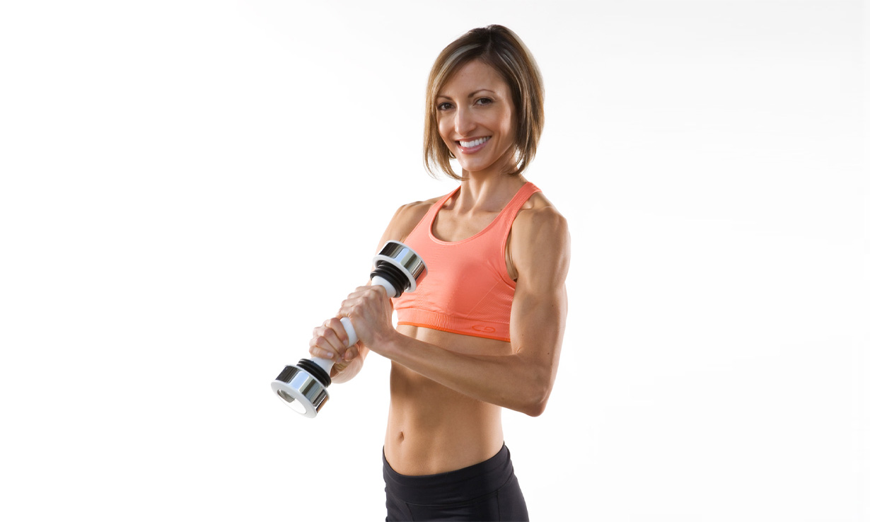 Woman using the Shake Weight