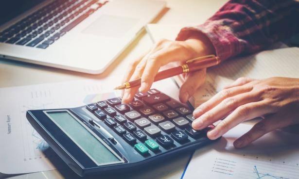 man working at calculator