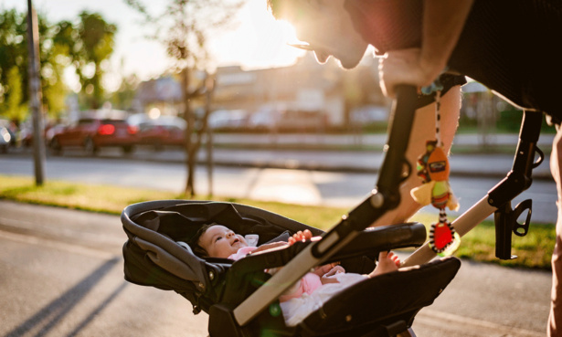 Parent looking at baby in pushchair in parent facing position