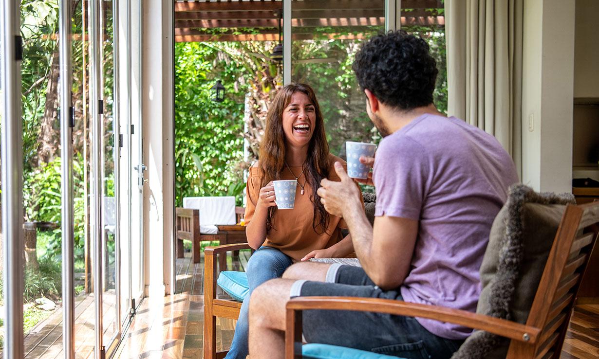 Friends drinking tea in a garden room