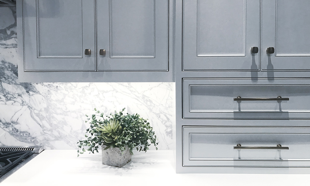 Grey kitchen cabinets with vintage kitchen door handles