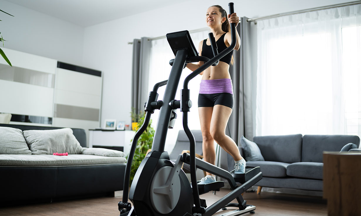 Woman using a cross trainer