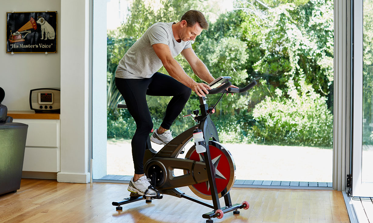 Man riding an exercise bike