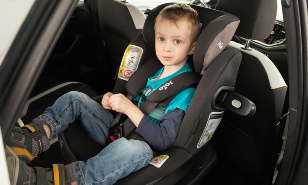 Boy sat in extended rear-facing car seat
