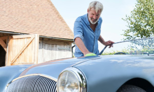 Man polishing his sports car