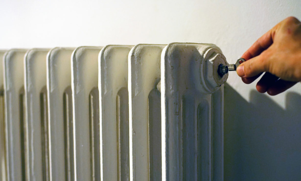 bleeding key inserted into radiator
