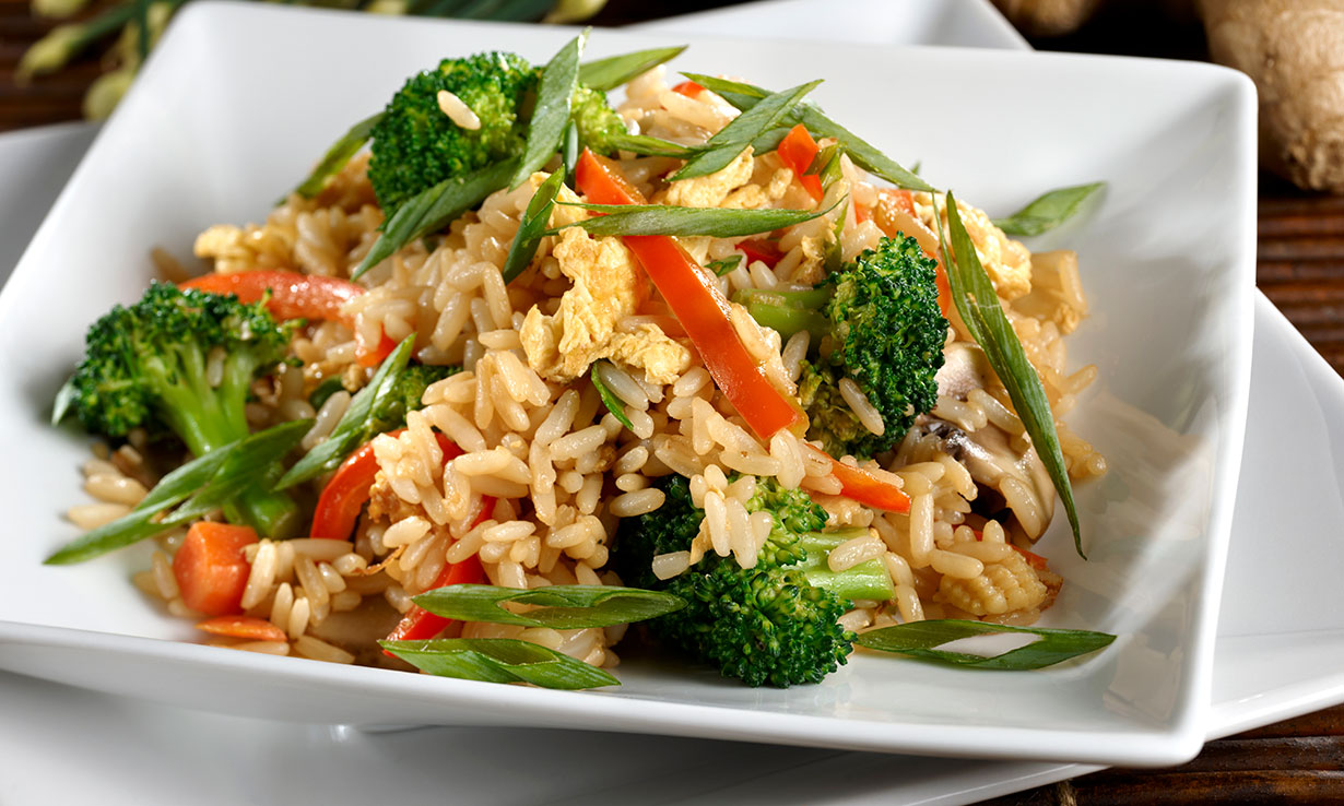 A plate of vegetable fried rice