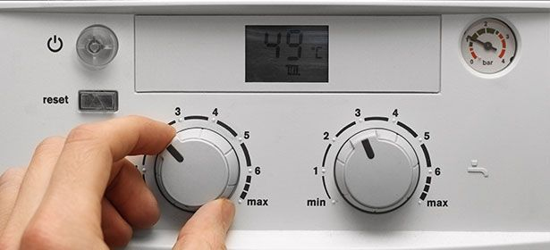 person setting boiler controls