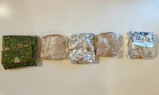 Line up of sandwiches wrapped in wraps.