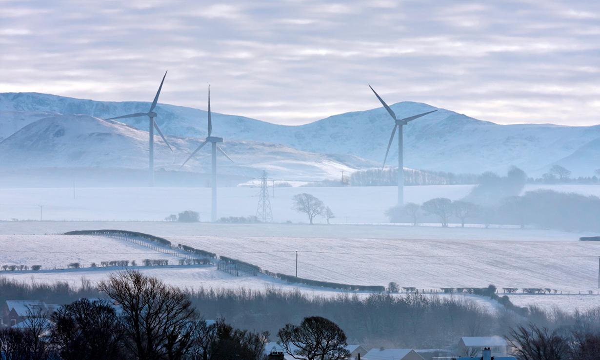 wind turbines in the mist