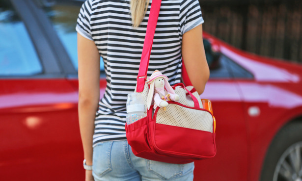 Woman with baby change bag