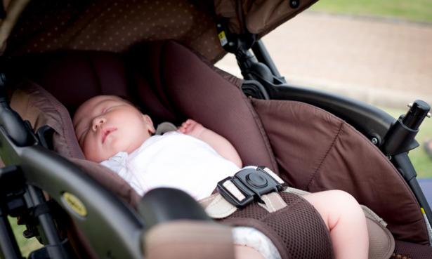 Baby asleep in pushchair