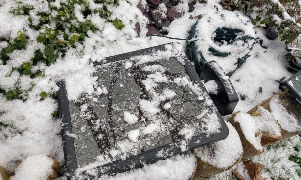Solar lights covered in snow.