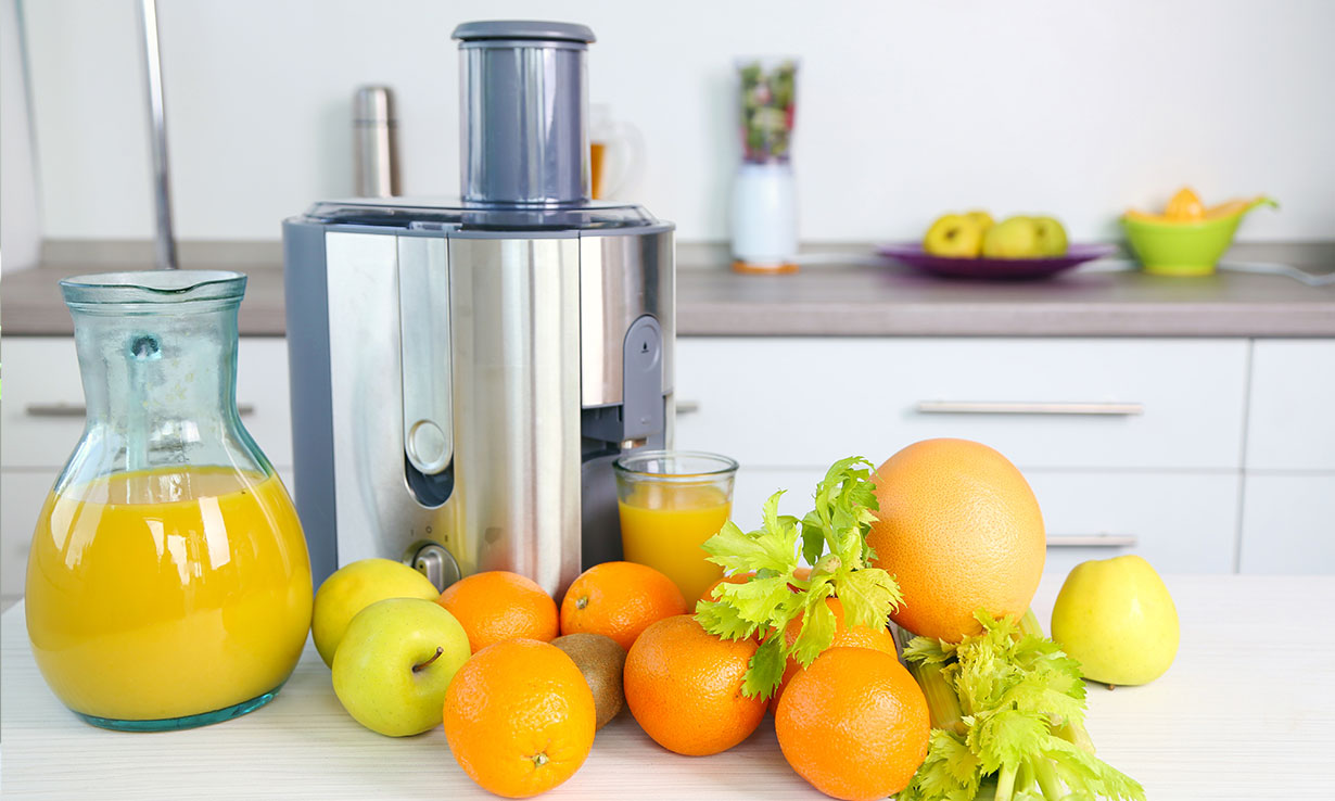 Juicer surrounded by fruit