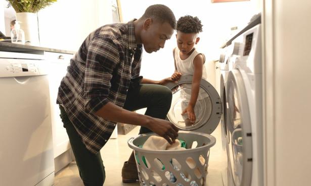 Parent using washing machine