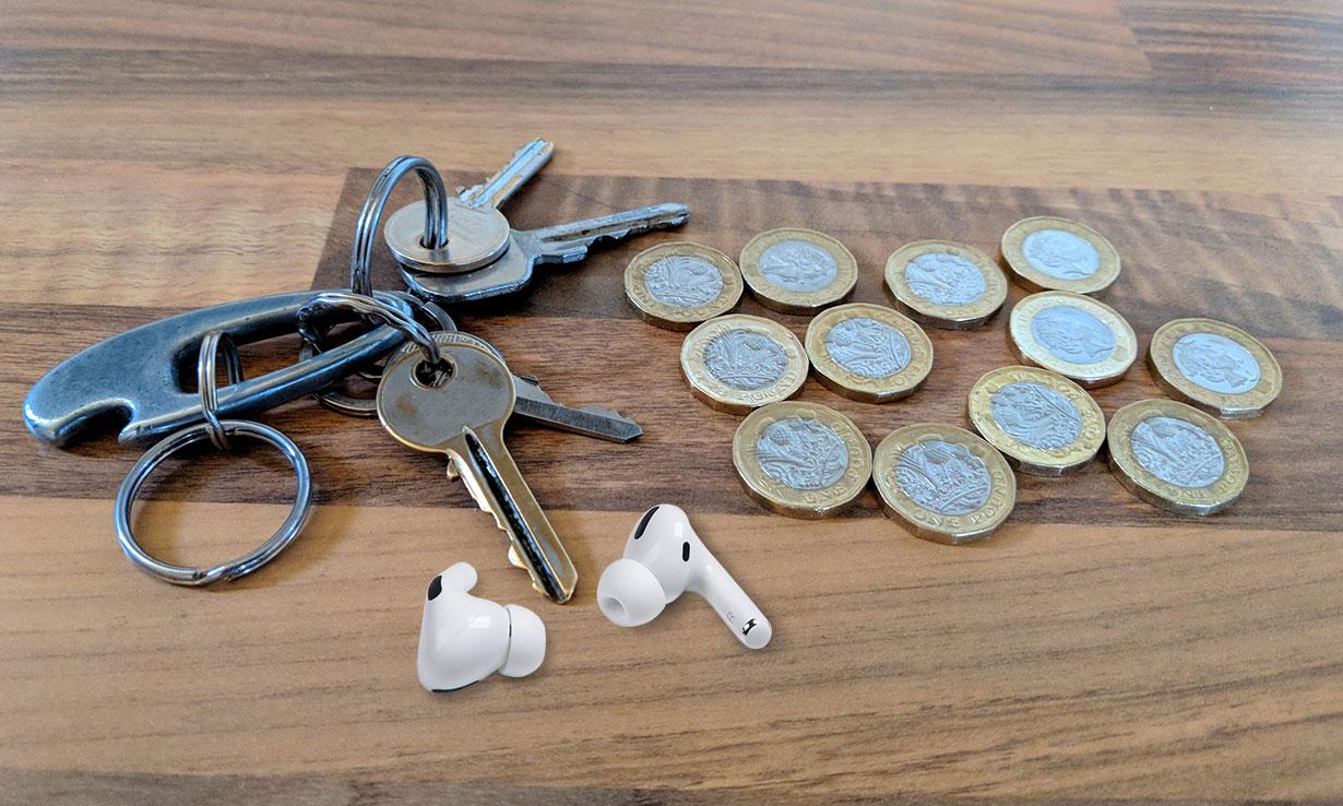 Keys, cash and headphones on a table
