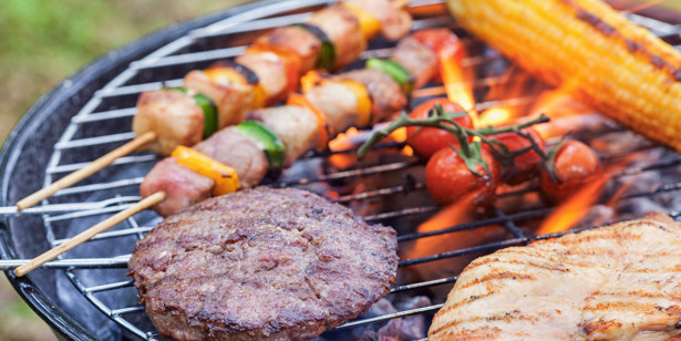 Burger and kebabs on a BBQ