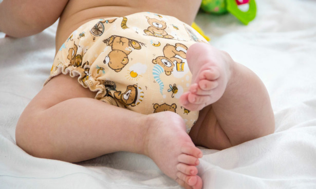 Baby wearing a reusable nappy